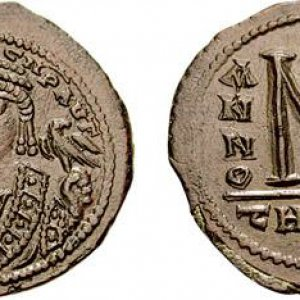A bronze coin minted in Theoupolis (Antioch), Byzantine Empire during the reign of Maurice (58...jpg